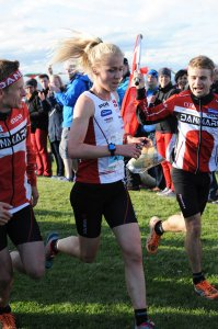 Maja Alm and Danish mix sprint team winning on Nairn Links, WOC2015